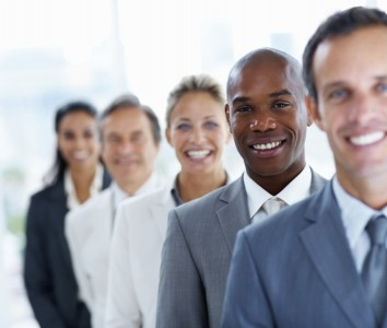 business-people-in-a-line-smiling